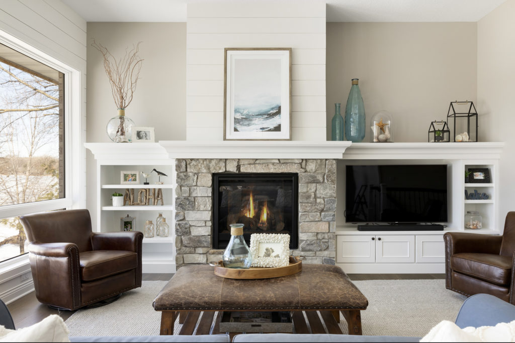 A luxurious living room with a fireplace and modern furnishings.